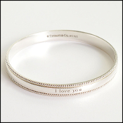 "Tiffany & Co. Sterling Silver ""I Love You"" Bangle Bracelet"